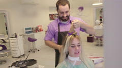 Beautiful Young Blond Woman in a Beauty Salon - stock footage