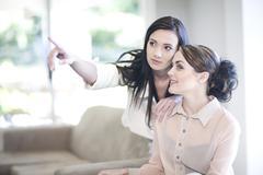 Interior designer advising client at home Stock Photos