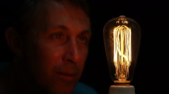 Man Antique Filament Bulb Amusement Stock Footage