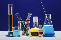 Chemical lab glassware: graduated cylinder, small beaker, beaker with two test Stock Photos