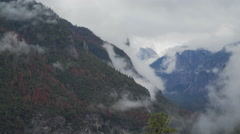 Time lapse of wispy clouds blowing through the Yosemite valley - stock footage