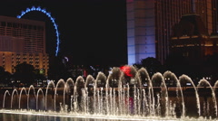 Fountains Starting on Las Vegas Strip with Hotel Buildings and No Logos Stock Footage
