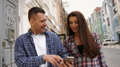 Couple of tourists in Madrid using smartphone Stock Footage