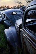 Vintage cars abandoned in scrap yard Stock Photos