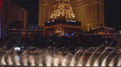 Las Vegas Nevada Bellagio Fountains with Bright Lights of Hotels Stock Footage