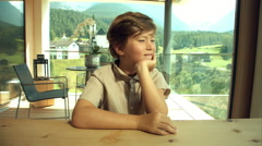 Happy kid enjoying view in house in the alps Stock Footage