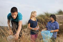 Teenagers collecting litter Stock Photos