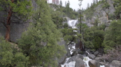 A swollen spring river crashes over rocks in Yosemite - stock footage
