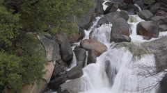 A brisk spring river rushes over rocks in Yosemite Stock Footage