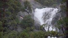 A swollen river crashes on rocks in the Yosemite valley - stock footage