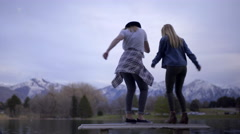 Fun Teen Girls Coordinate Dance Moves On Top Of Park Bench - stock footage