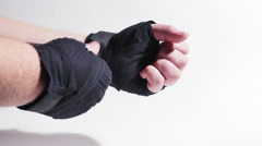 Boxer Unwrapping His Hands Isolated on White in Slow Motion - stock footage