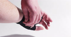 Boxer Unwrapping His Hands Isolated on White, 4K Stock Footage