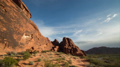 Timelapse morning clouds over desert cliff at sunrise Stock Footage