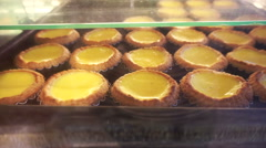 Famous Portuguese Hong Kong style famous egg tarts Stock Footage