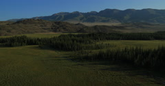 Aerial Shot of open rangeland with forest and mountains. Altai, Siberia. Stock Footage