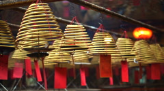 Chinese temple in Hong Kong iconic lanterns and Incense coils Stock Footage