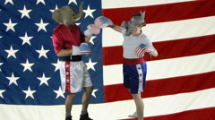 Political parties boxing against American Flag - stock footage