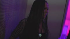 Beautiful brunette with dreadlocks dancing in the nightclub. Subculture Stock Footage