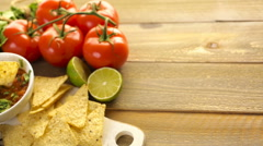Fresh salsa in white bowl with ingredients. Stock Footage
