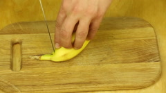 Man's hand cleans the banana peel Stock Footage