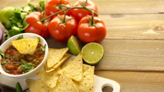 Fresh salsa in white bowl with ingredients. - stock footage