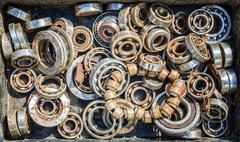 Assorted pile of ball bearing wheels in different sizes creates a retro theme Stock Photos