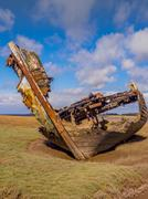 Old wooden and metal boats at Fleetwood Boat Graveyard, Fleetwood, Lancashire - stock photo