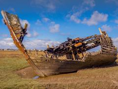 Old wooden and metal boats at Fleetwood Boat Graveyard, Fleetwood, Lancashire Stock Photos