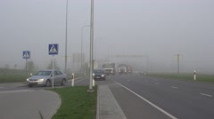 Cars traffic on city highway in heavy smog fog. Air pollution. 4K - stock footage
