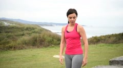 Athletic woman stretching after exercising Stock Footage
