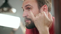 Man looking in the miror in the Barbershop. Slow Motion. Close Up - stock footage