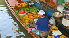 Cuisine on the boat - floating market in Bangkok - stock footage