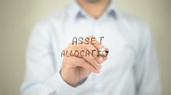 Asset Allocation   ,  man writing on transparent wall Stock Footage