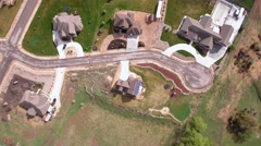 Aerial view flying over houses in a neighborhood Stock Footage