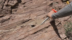 Man destroys bedrock using a hammer and chisel Stock Footage