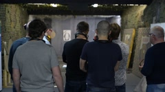 A group of men standing on a shooting range Stock Footage