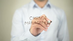 Change Management   ,  man writing on transparent wall - stock footage