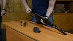 Man is disassembling and assembling the rifle on the speed Stock Footage