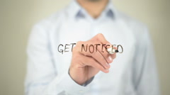 Get Noticed    ,  man writing on transparent wall Stock Footage