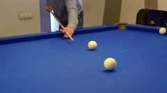 Playing Eight-ball pool billiards - stock footage