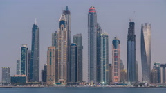 Dubai Marina skyline day to night timelapse as seen from Palm Jumeirah in Dubai Stock Footage