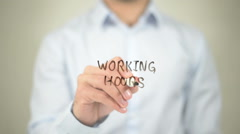 Working Hours   ,  man writing on transparent wall Stock Footage