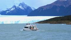 White ship running in front of Perito Moreno Glacier Stock Footage
