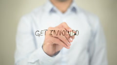 Get Involved   ,  man writing on transparent wall Stock Footage
