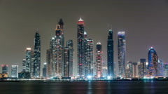 Dubai Marina skyline night timelapse as seen from Palm Jumeirah in Dubai, UAE Stock Footage