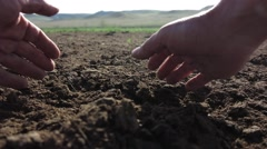 Farmer hand check the condition of the soil in early spring Stock Footage