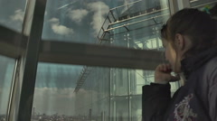 Girl in a glass elevator Stock Footage