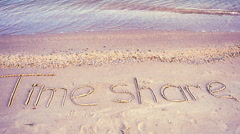 The inscription time share on sand, the beach. - stock footage