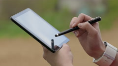 Woman Using Tablet PC Outdoors Stock Footage